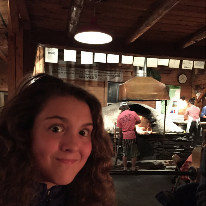 american_flatbread_girl_in_front_of_wood_oven