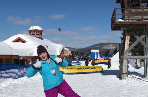child_celebrating_valcartier_raft_ride_in_snow