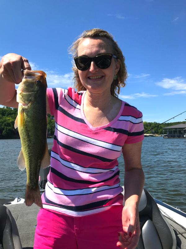 woman_holding_bass_fish