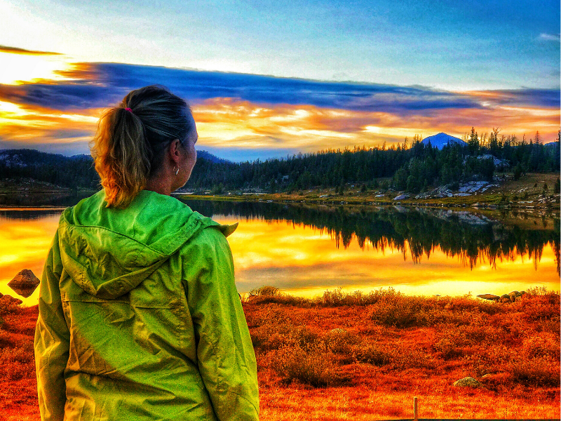 woman looking out over an alpine lake in Montana