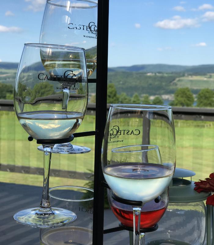 wine glasses in a tree on table overlooking Seneca Lake in Watkins Glen New York