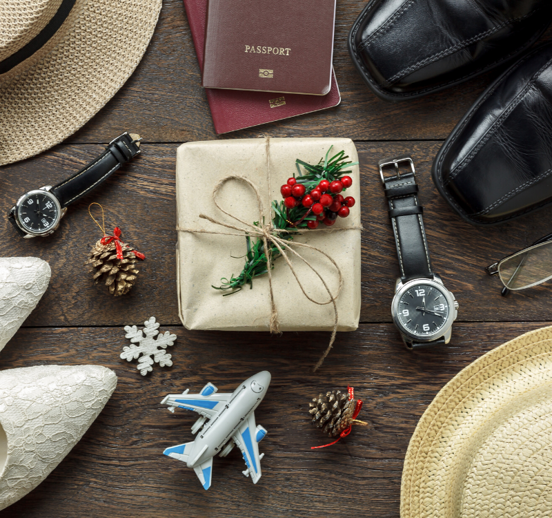 christmas travel packing materials and clothes and passports