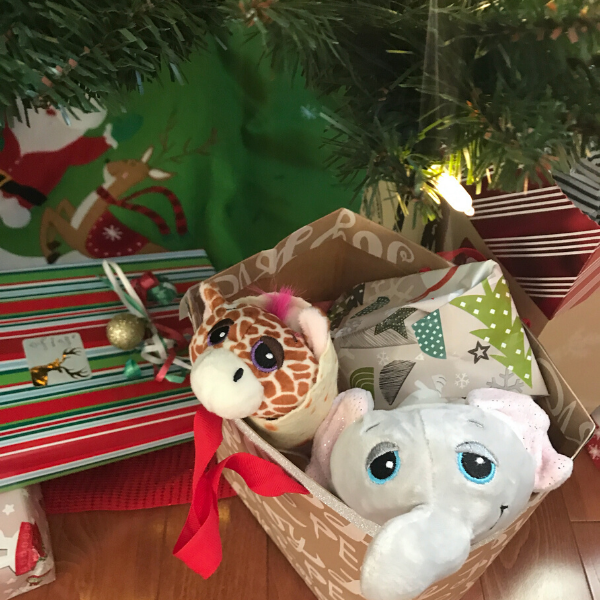 cutetitos gift under Christmas tree with baby giraffe and elephant