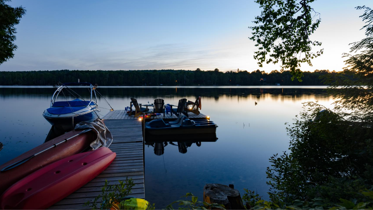 cottage-lake-at-night-muskoka-chairs-on-pier