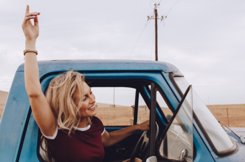 women_driving_leaning_out_the_window