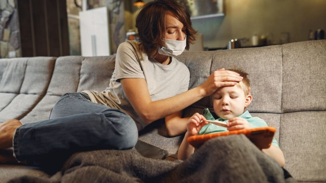 mom_in_mask_tending_sick_boy