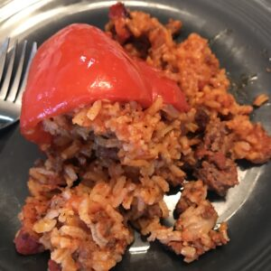 stuffed_red_peppers_with_ground_beef_on_black_plate