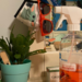 earth_friendly_cleaning_bottle_on_dresser_surrounded_by_plants